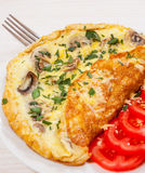 Omelet with mushrooms and cheese Royalty Free Stock Photography
