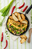 Omelet with mushrooms, lamb's lettuce, herbs and chilli Stock Photography