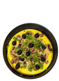Omelet with mushrooms, and olives in a frying pan. top view. isolated Stock Photo