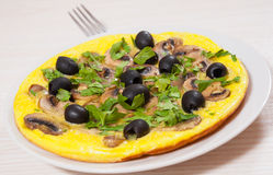 Omelet with mushrooms, and olives Royalty Free Stock Photos