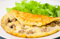 Omelet with mushrooms Stock Photos
