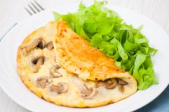 Omelet with mushrooms Stock Images
