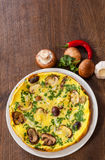 Omelet with mushrooms in a plate stock photography