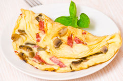 Omelet with mushrooms and salami Stock Images