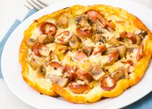 Omelet with mushrooms, sausage and cheese Stock Photography