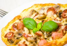 Omelet with mushrooms, sausage and cheese Royalty Free Stock Image