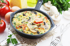 Omelet with mushrooms and tomatoes. Frittata Stock Photography