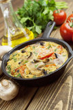 Omelet with mushrooms and tomatoes. Frittata Royalty Free Stock Photos