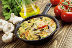 Omelet with mushrooms and tomatoes. Frittata Royalty Free Stock Images