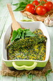 Omelet with nettles and green onions in a ceramic form Stock Images