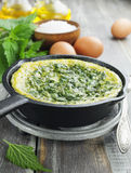 Omelet with nettles in the pan Royalty Free Stock Photography