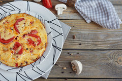 Omelet with onion, tomatoes and mushrooms. In beautiful white plates. Natural homemade food concept Stock Images