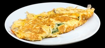 Omelet with organic spinach, cheese and mushrooms isolated on bl stock photo