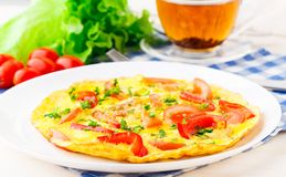 Omelet with paprika, tomato and herbs royalty free stock photos