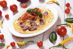 Omelet with pepperoni sausage and cherry tomato Royalty Free Stock Photography