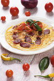 Omelet with pepperoni sausage and cherry tomato Royalty Free Stock Images