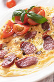 Omelet with pepperoni sausage and cherry tomato Stock Images