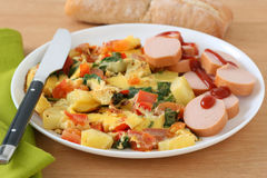 Omelet with potato and cut sausage Stock Photography