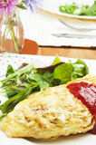 Omelet with rice. On a plate Royalty Free Stock Photo