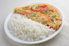 Omelet and rice. Aisan style Stock Images
