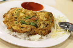 Omelet on the rice. Close up omelet on the rice with sauce royalty free stock image