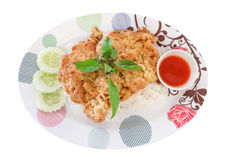 Omelet on rice with cucumber, basil, cup of chili sauce on white Stock Photography