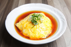 Omelet with rice inside. Royalty Free Stock Images