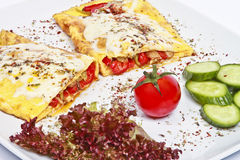 Omelet. With roasted peppers on wooden table royalty free stock image