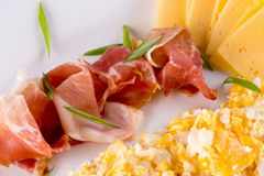 Omelet roll with cheese and ham slices on plate Royalty Free Stock Photography