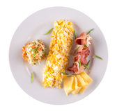 Omelet roll with cheese and ham slices on plate Stock Image