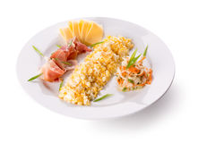 Omelet roll with cheese and ham slices on plate Stock Images