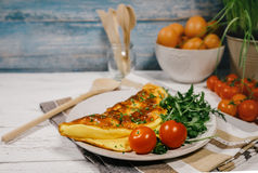 Omelet with ruccola and cherry tomatoes Royalty Free Stock Photo