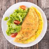Omelet and salad Royalty Free Stock Images