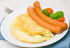 Omelet with sausage Stock Photos