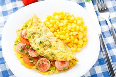 Omelet with sausage, tomato and herbs Stock Image