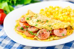 Omelet with sausage, tomato and herbs Royalty Free Stock Photography