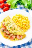 Omelet with sausage, tomato and herbs Stock Photos