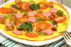 Omelet. With sausage, tomato and herbs on a plate Shallow DOF stock photo