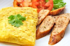 Omelet with sausage and vegetables. Close up stock photos