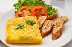 Omelet with sausage and vegetables. Close up Stock Photo