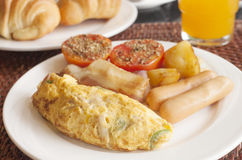 Omelet set for breakfast. Breakfast with omelet,sausages,bacon,potato and grille tomato on white plate Stock Photography