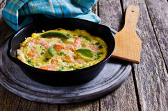 Omelet with shrimp and peas Royalty Free Stock Image