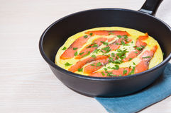 Omelet with smoked salmon Stock Images