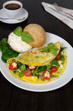 Omelet with spinach, basil, cherry tomatoes and cheese Adyg Royalty Free Stock Images