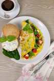 Omelet with spinach, basil, cherry tomatoes and cheese Adyg Stock Photo