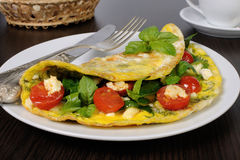 Omelet with spinach, basil, cherry tomatoes and cheese Adyg Stock Photography