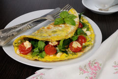 Omelet with spinach, basil, cherry tomatoes and cheese Adyg Stock Photos