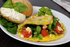 Omelet with spinach, basil, cherry tomatoes and cheese Adyg Royalty Free Stock Photo