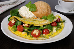 Omelet with spinach, basil, cherry tomatoes and cheese Adyg Stock Images