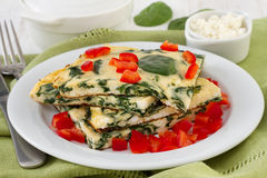 Omelet with spinach, cottage cheese Stock Photo